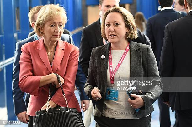 British Environment Food and Rural Affairs Secretary Andrea Leadsom and Conservative member of parliament AnneMarie Trevelyan walk along the bridge...