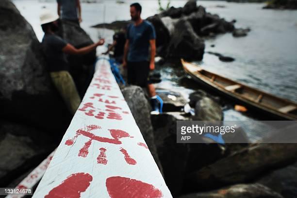 British environmentalist David de Rothschild , founder the community of adventurous environmentalists Myoo, helps install a totem pole on an island...