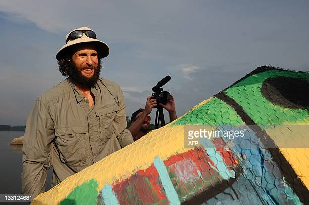 British environmentalist David de Rothschild founder the community of adventurous environmentalists Myoo looks at one of his sculptures being...