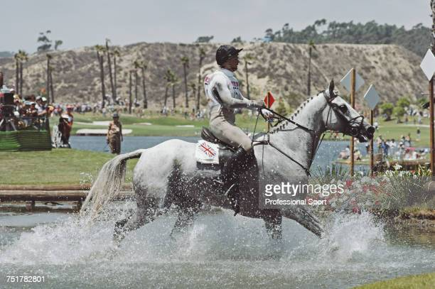 British equestrian Diana Clapham pictured in action for the Great Britain team on her horse 'Windjammer' at the water hazard during competition to...