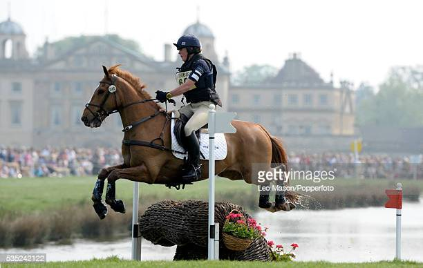 British equestrian Fiona Harris riding Law Choice exits the lake complex with Badminton House in the background during competition in the Cross...