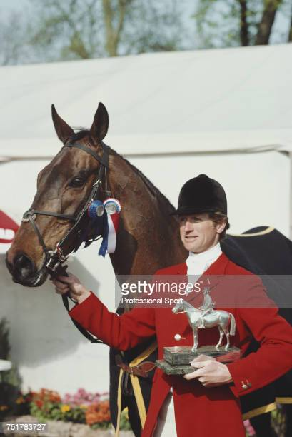 British equestrian Richard Meade pictured holding the trophy with his horse Speculator III after finishing in first place to win the 1982 Badminton...