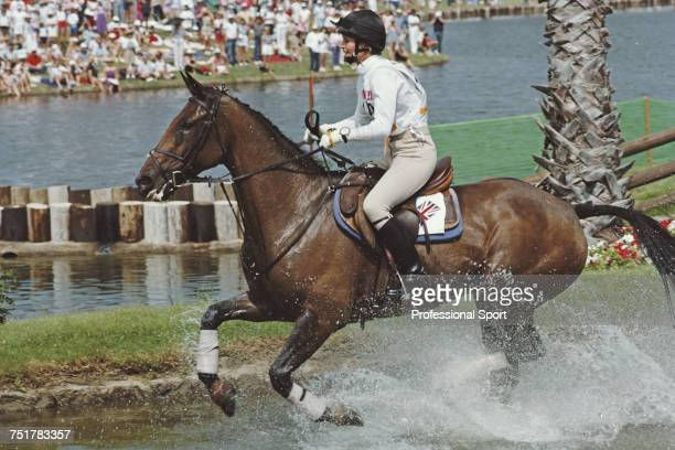 British equestrian Virginia Leng pictured in action for the Great Britain team on her horse 'Priceless' at the water hazard during competition to...