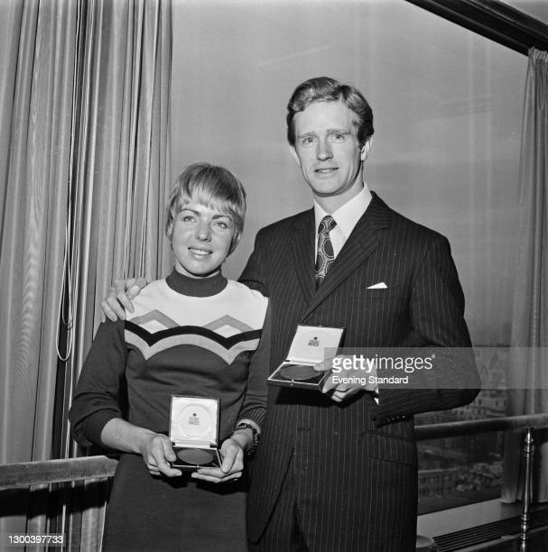 British equestrians Ann Moore and Richard Meade holding medals, UK, 6th December 1972.