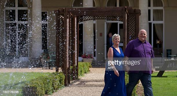 British Euro Millions winners Adrian and Gillian Bayford attend a photo call after winning £148000 on the EuroMillions in Hatfield Heath on August 14...