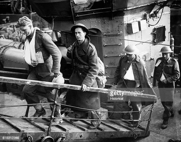 British evacuees from Dunkirk walk off their rescue vessel after landing in Britain June 1940