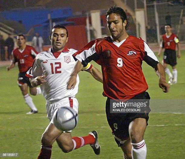 British Everton player Egyptian selection captain Ahmad Hossam 'Mido' takes control over the ball from Gohar alMenhari of the Tunisian national...