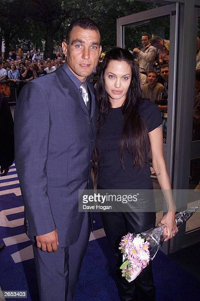 British ex footballer Vinnie Jones and American actress Angelina Jolie attend the film premiere of 'Gone in 60 Seconds' on July 26 2000 in London