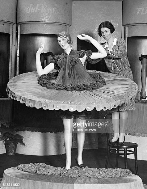 A British exhibit deisgner makes a model entirely from nylon stockings at a 1930s trade fair in London