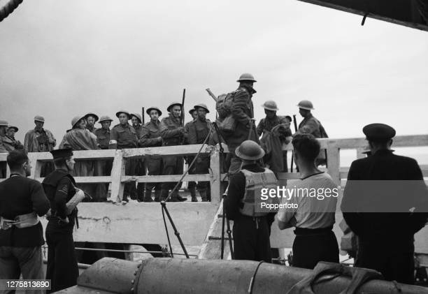 British Expeditionary Force soldiers board a rescue sea craft which will transport them back to England from Dunkirk part of a mission to evacuate...