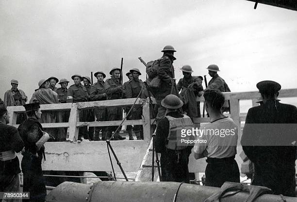 World War Two Dunkirk France British Expeditionary Force soldiers board a rescue sea craft which will transport them to Dunkirk to evacuate...