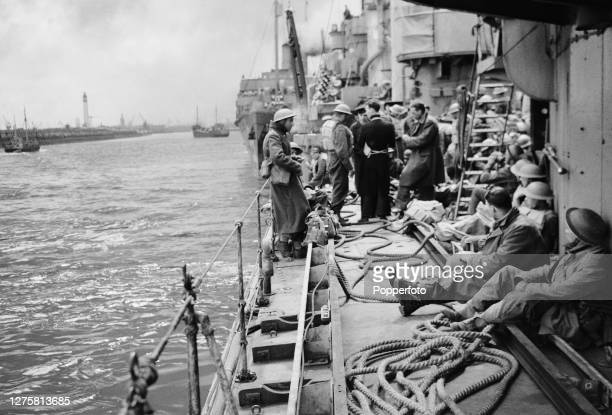 British Expeditionary Force soldiers from the British Army rest up on the deck of a Royal Navy rescue ship transporting them back to England from...