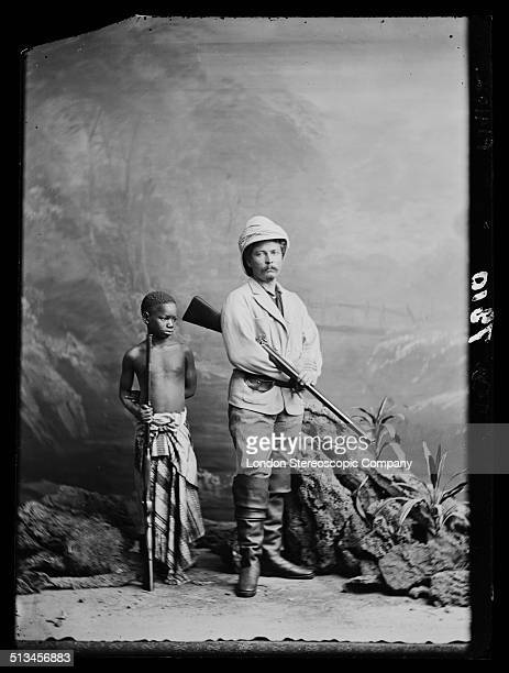 British explorer and journalist Sir Henry Morton Stanley with his personal servant and adopted child Kalulu circa 1872 Kalulu accompanied Stanley on...