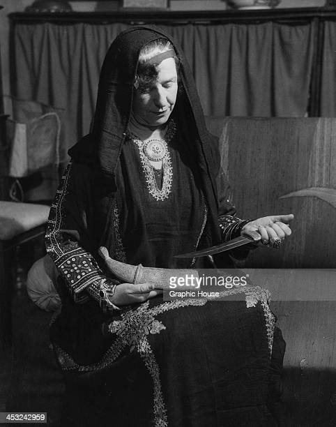 British explorer and travel writer Freya Stark at her home in Asolo Italy circa 1950 She is wearing traditional Persian dress and holding a dagger...