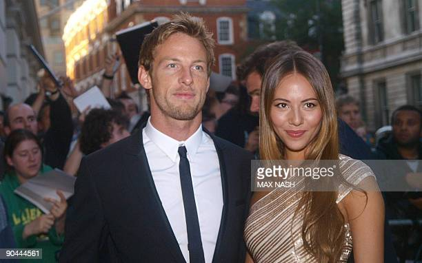 British F1 racing driver and F1 driver's championship leader Jenson Button arrives with Jessica Mishabata for the GQ Awards at the Royal Opera House...