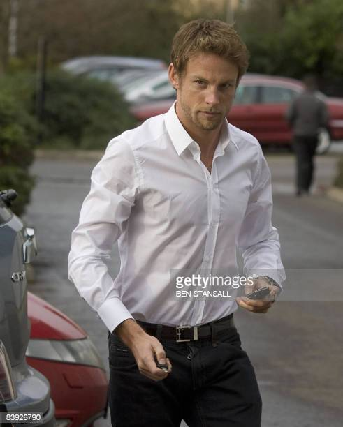British F1 racing driver Jenson Button arrives at the Honda F1 Racing Team headquarters in Brackley, Northamptonshire on December 5, 2008. Honda on...