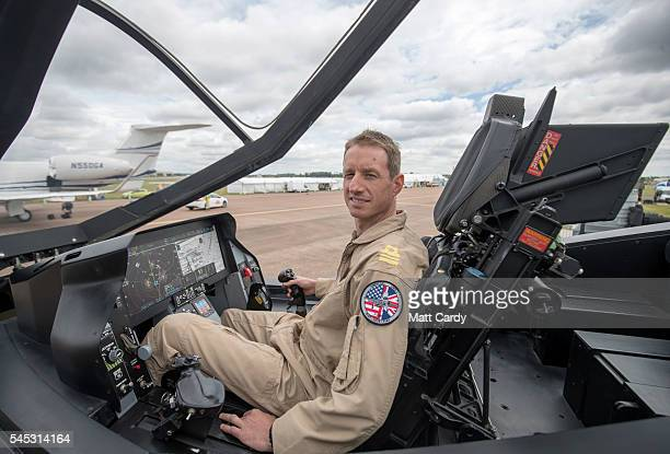 British F35 pilot Adam Hogg poses for a photograph inside a full size model of a F35 at RAF Fairford on the press preview day ahead of the Royal...