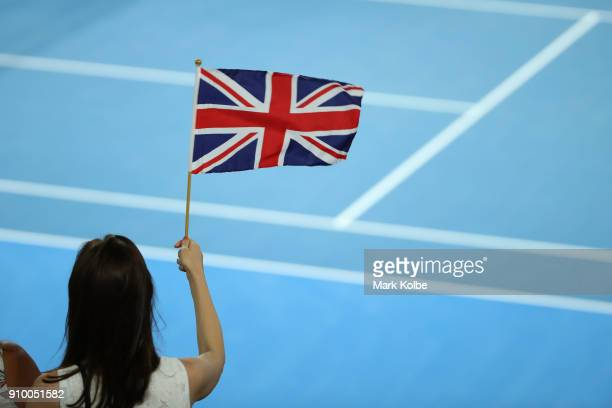 British fan waves the Union Jack flag watching Kyle Edmund of Great Britain play his semifinal match against Marin Cilic of Croatia on day 11 of the...