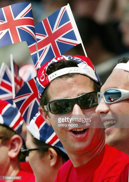 British fans cheer on Alan Mackin of Great Britain in his match against Mark Philippoussis of Australia during their Davis Cup World Group first...