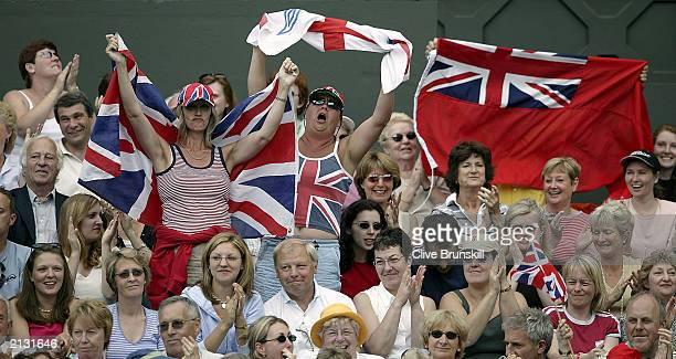 British fans on centre court cheer on Tim Henman of Great Britain against Sebastien Grosjean of France during the men's quarter finals at the...