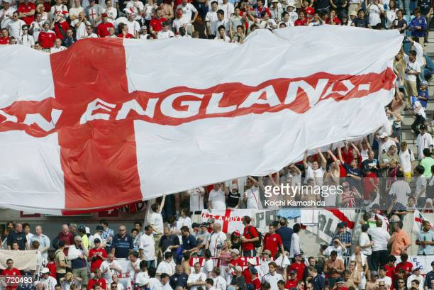 British fans unravel a large flag during a World Cup soccer match between England and Nigeria June 12 2002 at Nagai Stadium in Osaka Japan England...