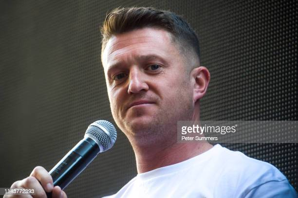 British farright activist and pundit Tommy Robinson speaks to his supporters outside the Old Bailey on May 14 2019 in London England Mr Robinson is...