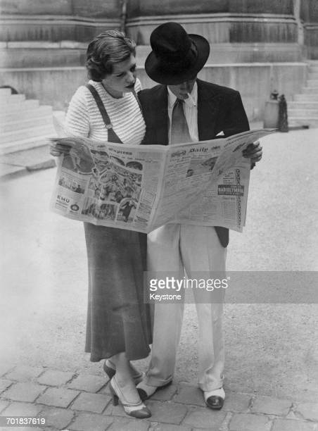 British fascist John Amery and his fiance actress Una Wing reading a copy of the Daily Express Paris 24th August 1932 The couple are attempting to...