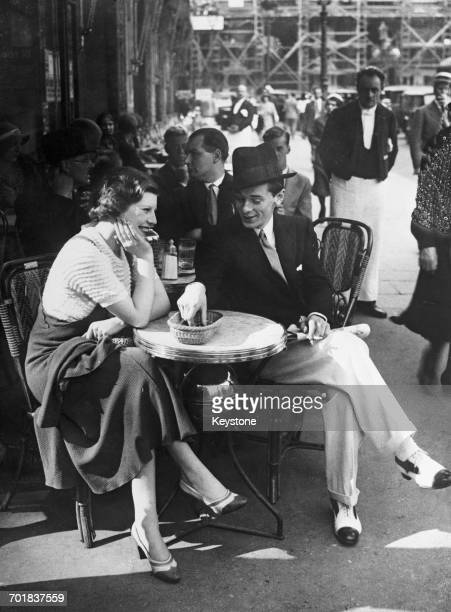 British fascist John Amery on a cafe terrace in Paris with his fiance actress Una Wing 24th August 1932 The couple are attempting to get married in...