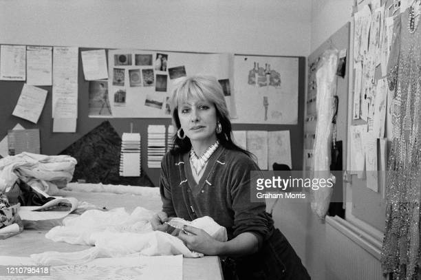 British fashion and textile designer Zandra Rhodes in her studio fabrics and drawings on the pin boards in the background in London England 9th April...