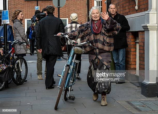 British fashion designer and activist Vivienne Westwood pushes her bicycle as she leaves the Ecuadorian embassy in central London on February 4 after...