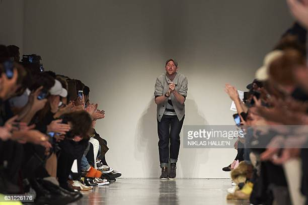 British fashion designer Christopher Raeburn greets the crowd after his catwalk show on the third day of the Autumn/Winter 2017 London Fashion Week...