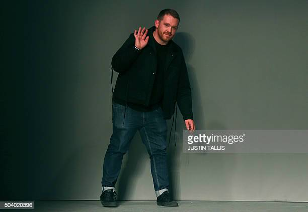 British fashion designer Craig Green waves to the audience after his show on the first day of the Autumn/Winter 2016 London Collections: Men fashion...