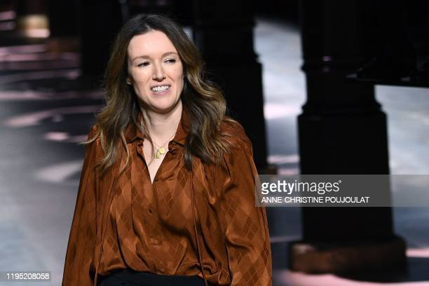 British fashion designer for Givenchy, Clare Waight Keller, acknowledges the audience at the end of the Women's Spring-Summer 2020 Haute Couture...