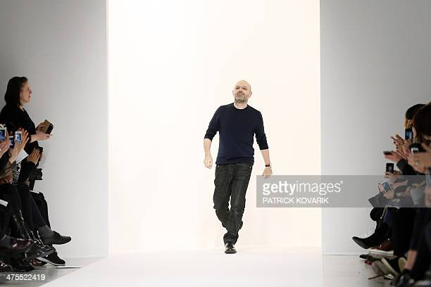 British fashion designer Hussein Chalayan acknowledges the audience at the end of his 2014/2015 Autumn/Winter readytowear collection fashion show on...