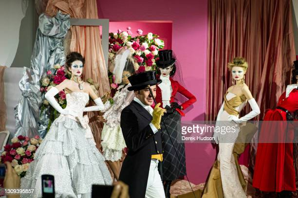 British fashion designer John Galliano pictured with models wearing his creations for the luxury fashion brand Dior during the winter haute couture...
