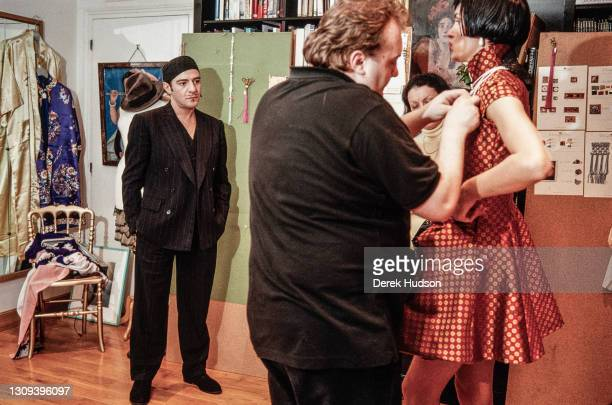 British fashion designer John Galliano pictured working with a fashion model and assistants during a fitting session in the original former wooden...