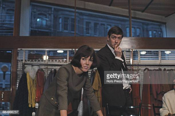 British fashion designer Mary Quant posed with her husband Alexander Plunket Greene in their Bazaar boutique clothes shop at 46 Brompton Road in...