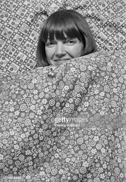 British fashion designer Mary Quant publicises her range of bed linen at a store, UK, 27th February 1974.