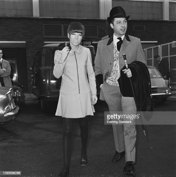 British fashion designer Mary Quant with Carnaby Street retailer Warren Gold of Lord John at Heathrow Airport in London, UK, 9th March 1967.