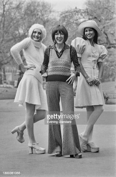 British fashion designer Mary Quant with two models at the launch of her Ginger Group autumn collection in London, UK, 2nd May 1972. Lorain on the...