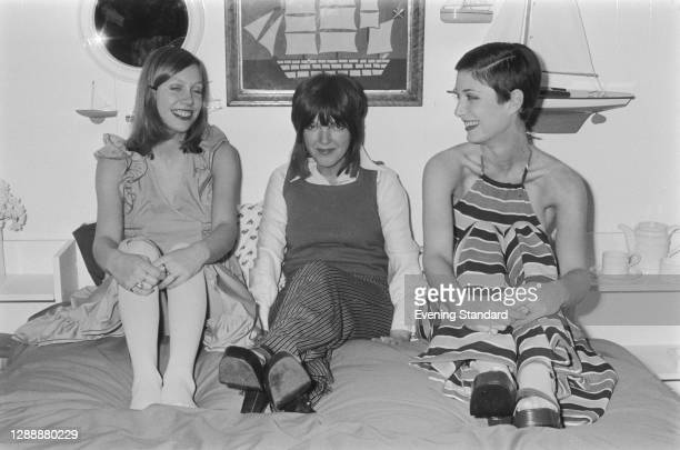 British fashion designer Mary Quant with two models in her nightwear designs, UK, November 1971.