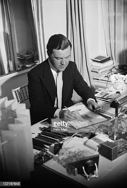 British fashion designer Norman Hartnell at work at his Bruton Street salon in Mayfair, London, November 1938. Original Publication: Picture Post -...