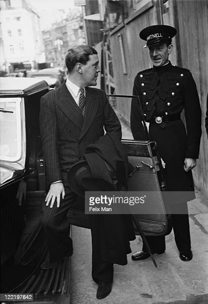 British fashion designer Norman Hartnell , with a doorman outside his Bruton Street salon in Mayfair, London, November 1938. Original Publication:...