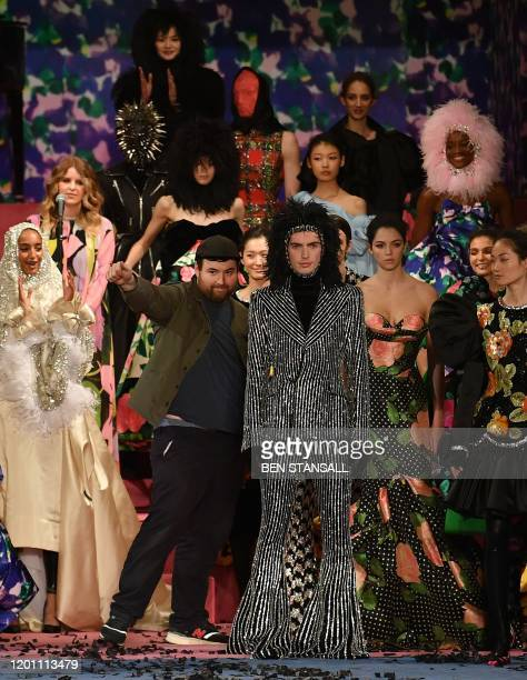 British fashion designer Richard Quinn poses with his models after presenting his catwalk show for the Autumn/Winter 2020 collection on the second...