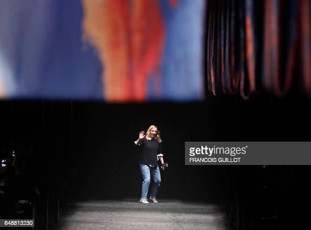 British fashion designer Sarah Burton acknowledges the audience following the Alexander McQueen women's FallWinter 20172018 readytowear collection...
