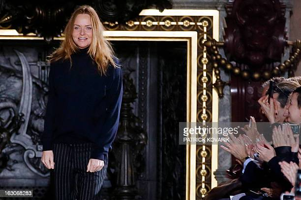 British fashion designer Stella McCartney acknowledges the public at the end of her Fall/Winter 20132014 readytowear collection show on March 4 2013...