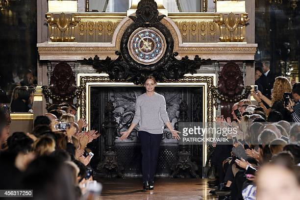 British fashion designer Stella McCartney acknowledges the public at the end of her 2015 Spring/Summer readytowear collection fashion show on...
