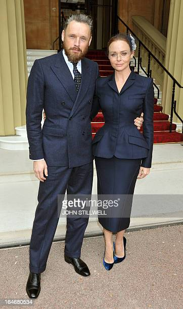 British fashion designer Stella McCartney arrives with husband Alasdhair Willis for an investiture ceremony at Buckingham Palace in central London on...