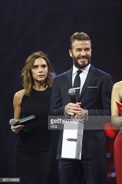 British fashion designer Victoria Beckham and British former footballer David Beckham stand on the stage during a gala of the 1111 Global Shopping...