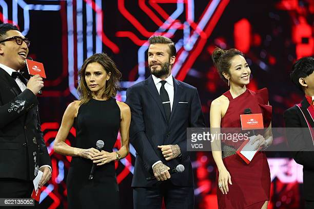 British fashion designer Victoria Beckham British former footballer David Beckham and Taiwanese model Pace Wu stand on the stage during a gala of the...
